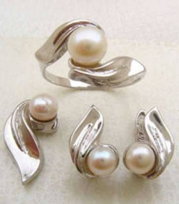 Real fresh water pearls set with rhodium plated